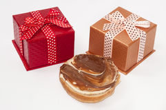 Gift boxes with chocolate on the bread Royalty Free Stock Photo