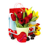 Gift boxes, chocolate and fresh flowers Royalty Free Stock Photography