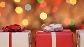 Gift boxes for christmas against blurry lights stock video footage