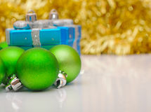 Gift boxes and christmas balls Royalty Free Stock Photography