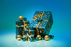 Gift boxes and christmas balls,Isolated on blue background Royalty Free Stock Image