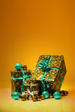 Gift boxes and christmas balls,Isolated on orange background Royalty Free Stock Photography