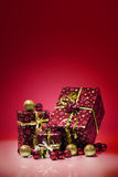 Gift boxes and christmas balls,Isolated on red background Royalty Free Stock Images