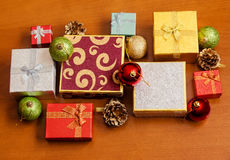 Gift boxes and christmas  balls on wooden background. Selective focus Stock Photos