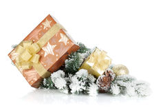 Gift boxes and christmas decor on snowy fir tree Royalty Free Stock Images