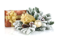 Gift boxes and christmas decor with snowy fir tree Royalty Free Stock Image