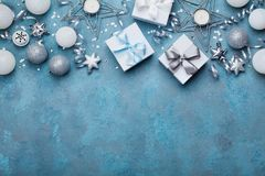Gift boxes and christmas decoration on vintage turquoise background top view. Flat lay. Festive border for greeting card. Gift boxes and christmas decoration on Royalty Free Stock Image