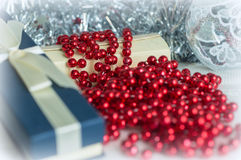 Gift boxes among Christmas decorations Royalty Free Stock Photos