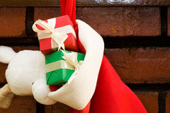 Gift boxes in a Christmas sock Royalty Free Stock Photography