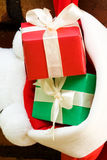 Gift boxes in a Christmas sock Stock Images