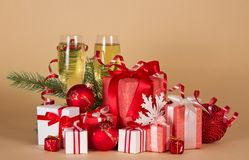Gift boxes, Christmas toys, serpentine and wine Stock Image