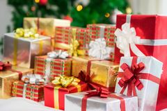 Gift boxes with Christmas tree. At the background for surprise Children in New year or Xmas party festival. Christmas party event and Happy new year theme Royalty Free Stock Image