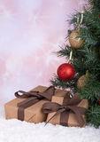 Gift Boxes by a Christmas Tree Royalty Free Stock Image