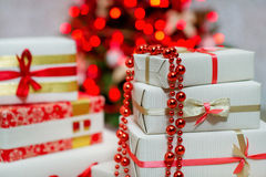 Gift boxes and Christmas tree lights Royalty Free Stock Photo