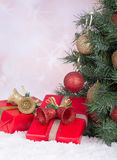 Gift Boxes by a Christmas Tree Stock Images