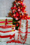 Gift boxes by the Christmas tree Royalty Free Stock Image