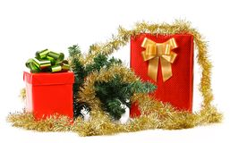 Gift boxes with Christmas tree and tinsel. Royalty Free Stock Image