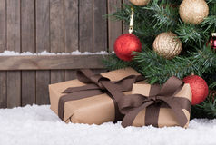Gift Boxes by a Christmas Tree Royalty Free Stock Photos