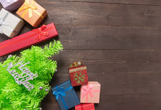 Gift boxes and Christmas tree on the wooden background with empt Royalty Free Stock Photo