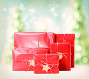 Gift boxes on christmas trees background Stock Photos