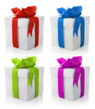 Gift boxes with color bows. Set of four gift boxes with color bows on white background Royalty Free Stock Photo