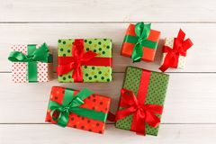 Christmas gift boxes, top view on wood table background. royalty free stock images