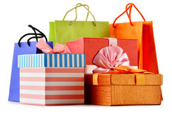 Gift boxes and colorful gift bags isolated on white Royalty Free Stock Images