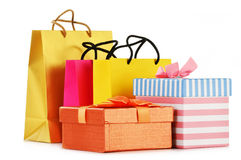 Gift boxes and colorful gift bags on white Royalty Free Stock Photos