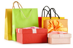 Gift boxes and colorful gift bags on white Royalty Free Stock Images