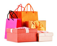 Gift boxes and colorful gift bags on white Royalty Free Stock Photography