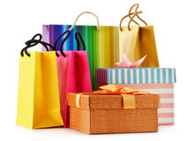 Gift boxes and colorful gift bags on white Stock Photography