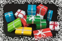 Gift boxes and colorful present for christmas on blackboard. Top view with copy space. stock photos