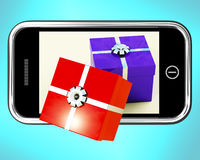 Gift Boxes Coming From Mobile Phone. Showing Buying Presents Online Royalty Free Stock Image
