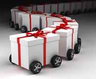 Gift boxes convoy on wheels. Concept Royalty Free Stock Photos