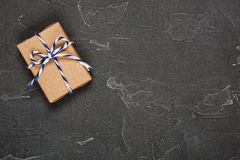 Gift boxes in craft paper on concrete background. Gift boxes in a craft paper on concrete background royalty free stock photo