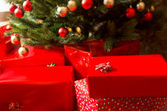 Gift boxes and decorated christmas tree, closeup Stock Image