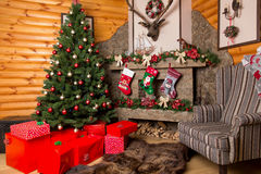 Gift boxes, decorated christmas tree and fireplace Stock Photo