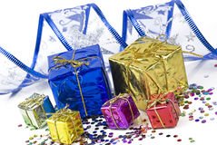 Gift boxes and decorative ribbon on a background of confetti Royalty Free Stock Photo