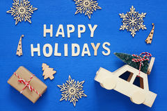 gift boxes, decorative snowflakes, christmas tree and and toy ca Stock Images