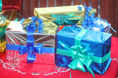 Gift boxes of different colors. Some gift boxes on a red tablecloth Royalty Free Stock Image