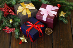 Gift boxes with festive ribbons and Christmas decorations Royalty Free Stock Image