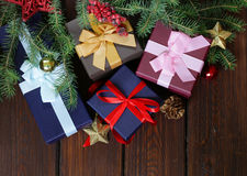 Gift boxes with festive ribbons and Christmas decorations Royalty Free Stock Photo