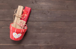 Gift boxes and flower pot are on the wooden background with empt Stock Photography
