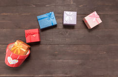 Gift boxes and flower pot are on the wooden background with empt Royalty Free Stock Photography