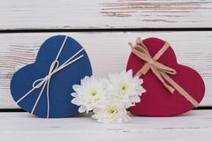 Gift boxes and flowers on wooden background. royalty free stock images