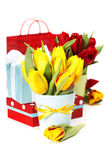 Gift boxes and fresh flowers Stock Photography