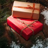gift boxes and fur tree on wooden background Royalty Free Stock Photography