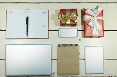Gift-boxes and gadgets. Objects and gadgets for buiness planning and two packed gifts Royalty Free Stock Photography