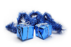 Gift boxes and garland on white backgroun. Two blue gift boxes and garland on white background Royalty Free Stock Images