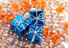 Gift boxes on the gems Stock Images